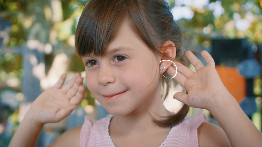 Proud little heroine with new earrings: Earrings for children